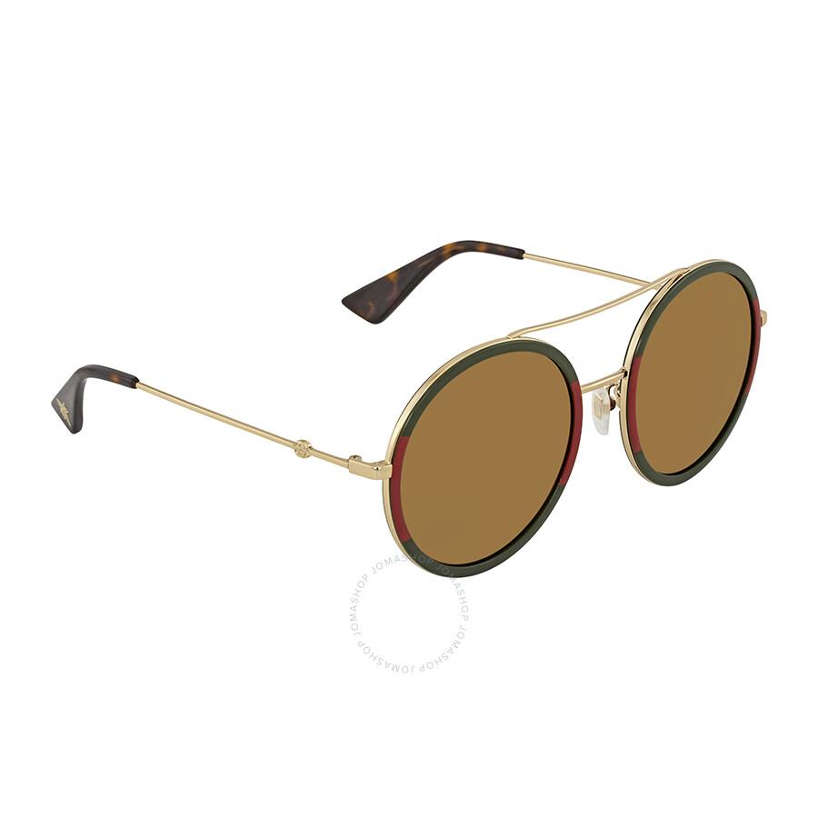da4efee0ce Gucci Gold Round Ladies Sunglasses GG0061S 012 56 - Gucci ...