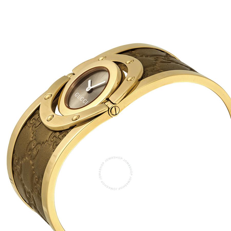 010e6de79f2 Gucci Twirl Brown Dial Gold-tone Steel with Leather Bracelet Ladies Watch  YA112434