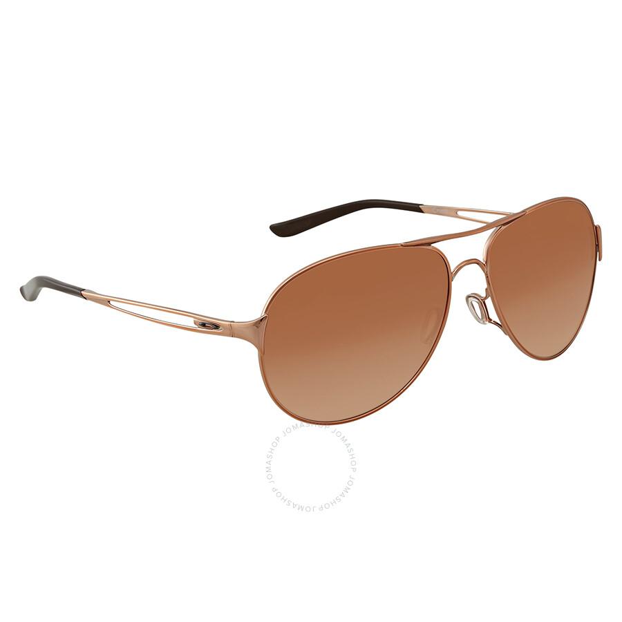 69864a2e7a3b1 Oakley Caveat Brown Gradient Aviator Ladies Sunglasses OO4054-405401-60 ...